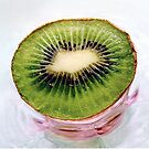 Kiwi Fruit on a Pink and Blue Glass Plate by LouiseK