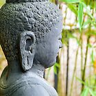 statue of buddha in zen garden by 7horses
