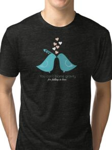 You cant blame gravity for falling in love love birds kissing T-Shirts and Gifts Tri-blend T-Shirt