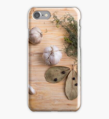 Top view of the garlic and dried spices for cooking food  iPhone Case/Skin