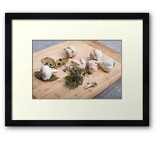 Wooden board with garlic and dried spices closeup Framed Print