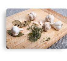 Wooden board with garlic and dried spices closeup Canvas Print