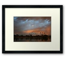 Layers of clouds at the lake Framed Print