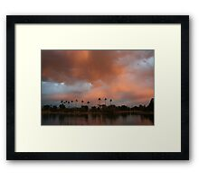 Pink clouds looming over the lake Framed Print