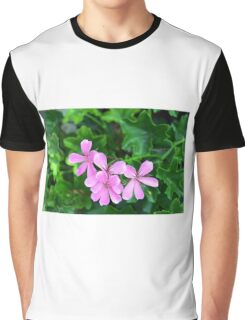 Pink flowers on green leaves background Graphic T-Shirt