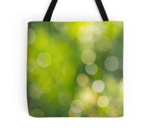 natural blur bokeh of foliage of tree crowns in the daytime Tote Bag