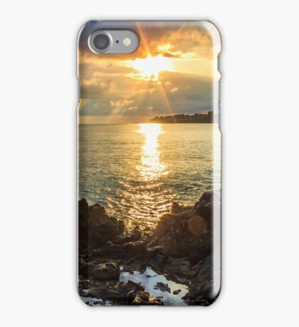 Menacing morning sea landscape with rocky coast and rising sun rays iPhone Case/Skin
