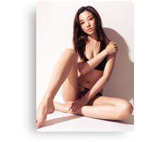 Sexy asian woman in bikini sitting against white wall art photo print Canvas Print