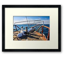 stem deck of a ship coming over the sea towards the island Framed Print