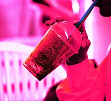 Surreal image of young woman drinking ice drink with straw by edwardolive