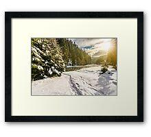 frozen river in forest at sunset Framed Print