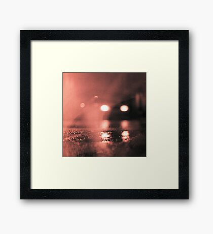 Analog photo of tarmac of street at night with car headlights in rain Framed Print