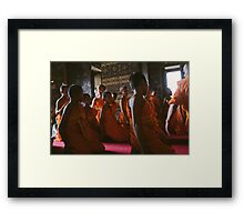 Young monks praying Framed Print