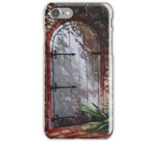 Decorative door in archway set in stone wall surrounded by plants iPhone Case/Skin