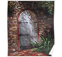 Decorative door in archway set in stone wall surrounded by plants Poster