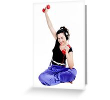 Girl sitting doing exercise with dumbbells Greeting Card