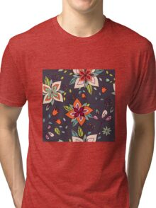 Retro 60's flower design in green and orange, a pretty repeating floral design on a black background, classic statement fashion clothing, soft furnishings and home decor  Tri-blend T-Shirt