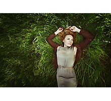 Beautiful young woman lying in the grass Photographic Print