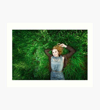 Beautiful meditative young woman lying in the grass Art Print