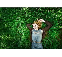 Beautiful meditative young woman lying in the grass Photographic Print