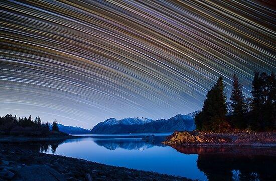 Calm Mountain Lake startrails by focuscreative