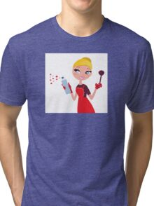Beautiful blond Woman in red apron cleaning and cooking for Christmas Tri-blend T-Shirt