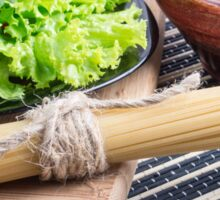 View close-up on uncooked pasta and spaghetti with green salad Sticker