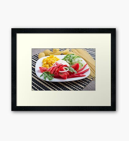 White plate with slices of fresh tomatoes, cucumber, corn, arugula and onions Framed Print