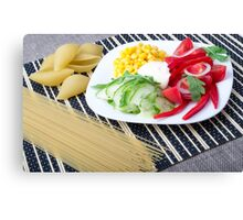 Pieces of fresh raw vegetables on a white plate Canvas Print