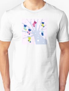 Winter colorful socks hanging from tree Unisex T-Shirt