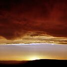 Underneath Stormclouds: Sunset at Fish River Canyon by Carole-Anne