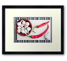 Chilli peppers and garlic in a wooden bowl Framed Print