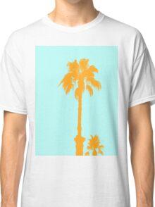 Orange palm trees silhouettes on blue Classic T-Shirt