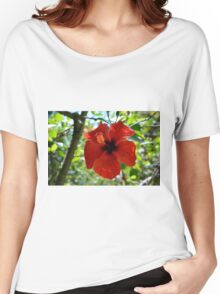 Red hibiscus flower and green leaves background Women's Relaxed Fit T-Shirt