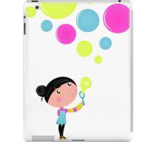 Little Girl blowing Soap bubbles iPad Case/Skin