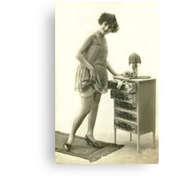 A 1920s Flapper Girl standing next to a set of drawers  Canvas Print