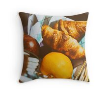 Picnic Basket With Orange Juice Bottle, Apples, Peaches, Oranges And Croissants On Green Grass In Spring Throw Pillow