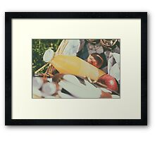 Picnic Basket With Orange Juice Bottle, Apples, Peaches, Oranges And Croissants On Green Grass In Spring Framed Print