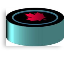 Hockey puck with red maple leaf Canvas Print