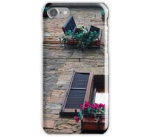 Stone building facade from Assisi with shutter and flowers iPhone Case/Skin