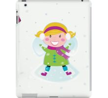 Happy christmas girl in winter nature making angel iPad Case/Skin
