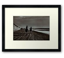 Young Couple Riding Horses at the Beach Framed Print