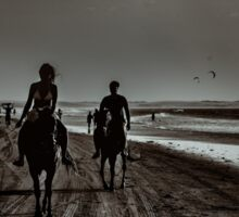 Young Couple Riding Horses at the Beach Sticker