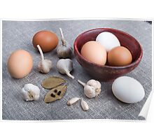Raw eggs and garlic and spices on the kitchen table Poster