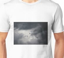 Crow flying in stormy sky Unisex T-Shirt