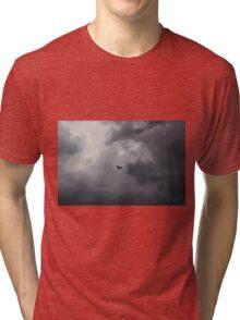 Buzzard flying in stormy sky Tri-blend T-Shirt