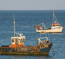 Two old fishing boats  by Judi Lion