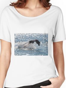 Flyboarder diving forwards headfirst into backlit sea Women's Relaxed Fit T-Shirt