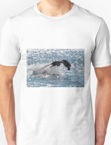 Flyboarder diving forwards headfirst into backlit sea T-Shirt