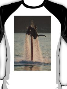 Flyboarder doing back flip surrounded by spray T-Shirt